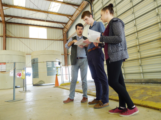 Savannah River Nuclear Solutions engineer Sam McGill (left) works with Aiken High School juniors Jared Kekelak and Izzy Pyle during an exercise designed to demonstrate a typical workday activity for SRNS employees working within the Solid Waste organization.